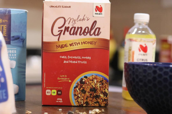 chocolate flavour granola with honey and bottle of lemonade - nylahs